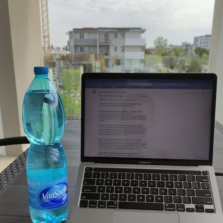 Work Macbook with a background view of a construction site