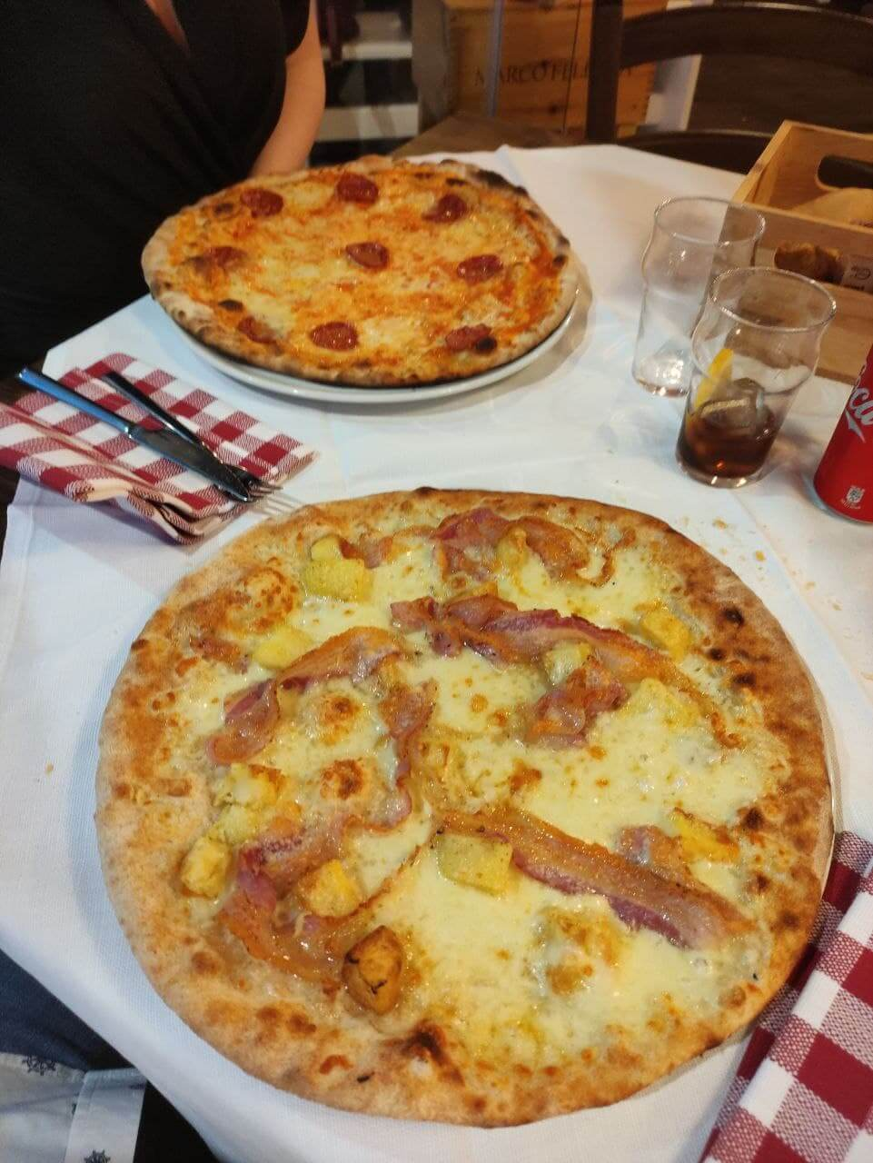 Two Pizzas one with pepperoni/salame and another custom one